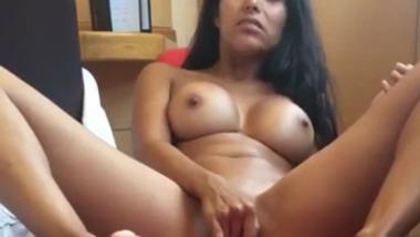 Busty Delhi girlfriend masturbates using a dildo